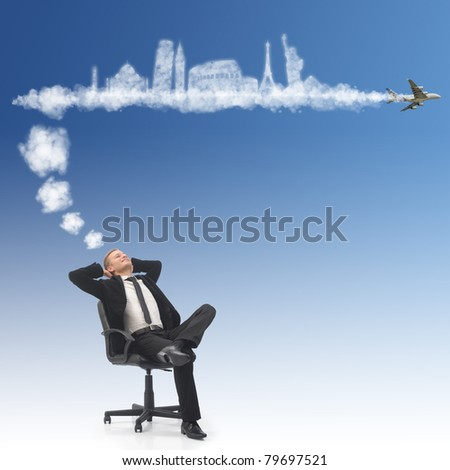 Business man dreaming about his holidays - stock photo
