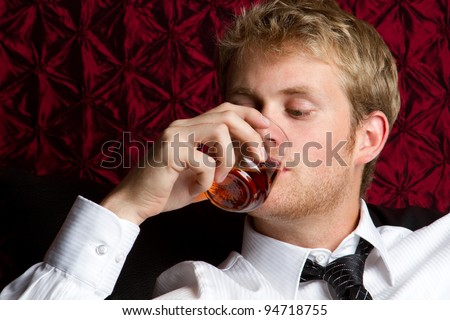 Business man drinking scotch alcohol