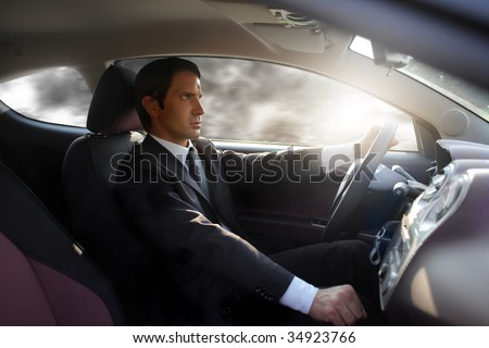 business man driving a sport car - stock photo