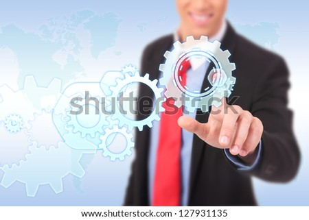 business man driving business process gear of vision - stock photo