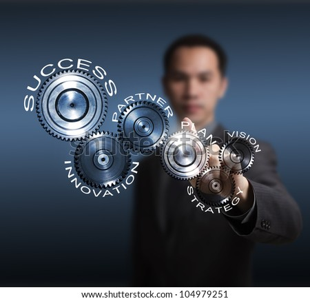 business man driving business process gear of vision - strategy - plan - partner - innovation - success - stock photo