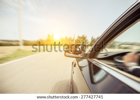 business man driving fast. side view of a man on his car. concept about car, transportation, business, and people - stock photo