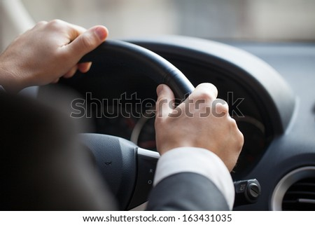 Business man driving his car - stock photo