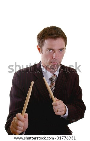 business man drumming up sales with a drumstick roll - stock photo