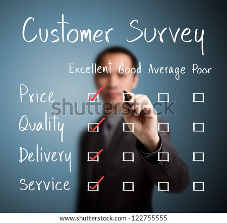 business man evaluate excellence on customer survey form - stock photo