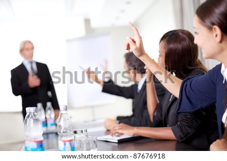 Business man explaining to his sales team - stock photo