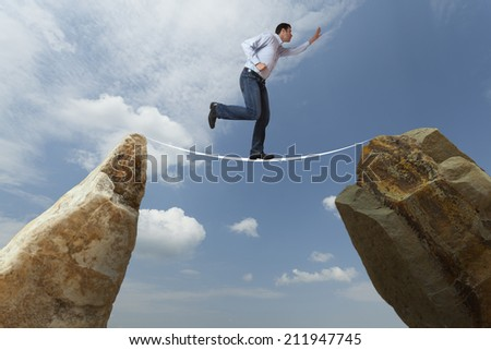 Business man facing challenges - stock photo