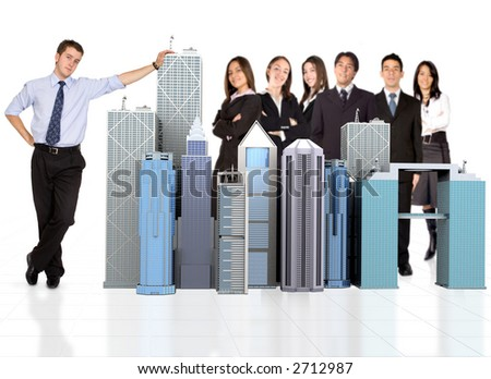 business man facing the camera with his team behind him - stock photo