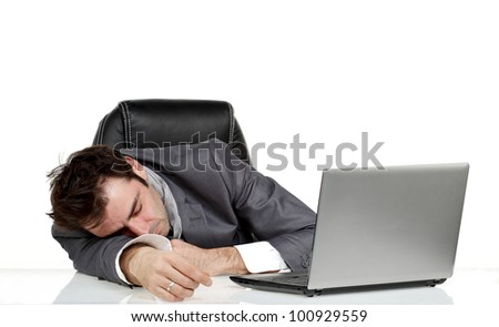Business man fall asleep on his office table in front of his lap top - stock photo