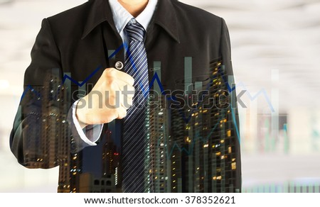 business man fist hand double exposure night life building and bar graph confident success concept - stock photo