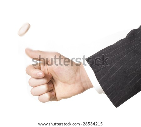business man flipping a coin - stock photo
