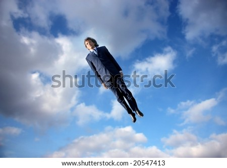 business man flying in the sky - stock photo