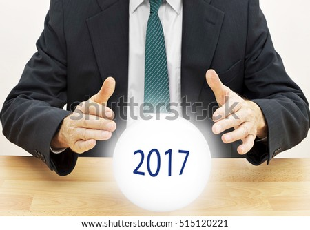 Business man fortune teller, predict the future 2017. With crystal ball.