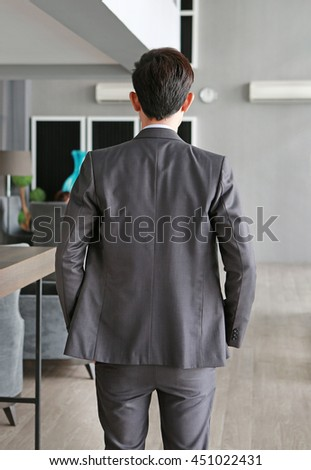 business man from the back on workplace in office - stock photo