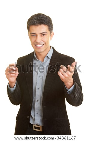 Business man gesticulating while holding a speech - stock photo