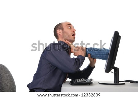 business man getting strangled by the computer - stock photo