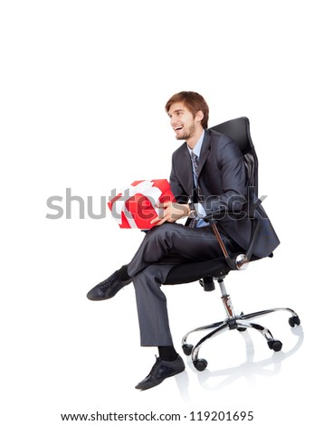 Business man give gift box in chair to side up corner empty copy space, businessman give red present, sitting in armchair, happy smile, Isolated over white background - stock photo