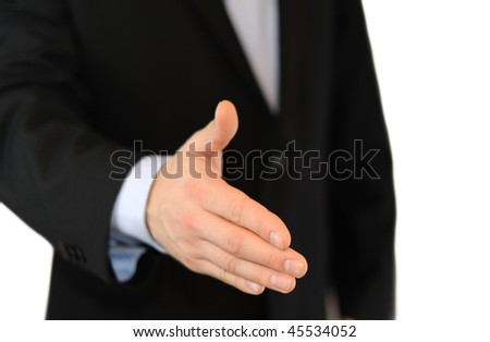 Business man giving a hand shake isolated on white
