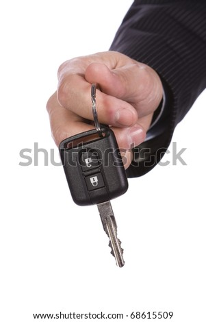 Business man giving a new key car - stock photo