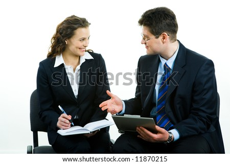 Business man giving a working advice to young woman - stock photo
