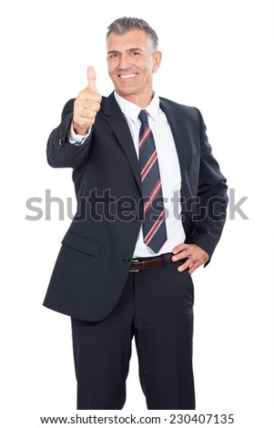 Business Man giving thumbs up sign.