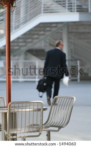 Business man going back to work after lunch - stock photo