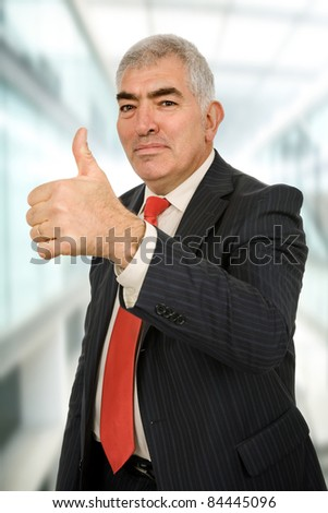 business man going thumb up at the office