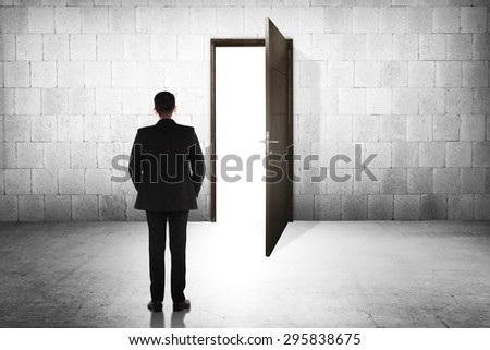 Business man going to the open door. Career path conceptual