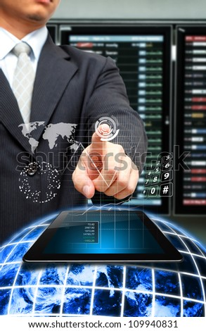 Business man got the Data report from digital touch pad on globe : Elements of this image furnished by NASA - stock photo