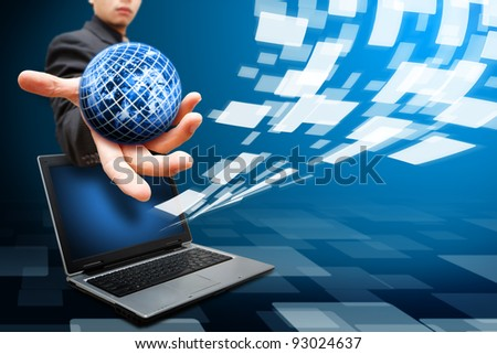 Business man grab the globe on notebook computer and windows background - stock photo