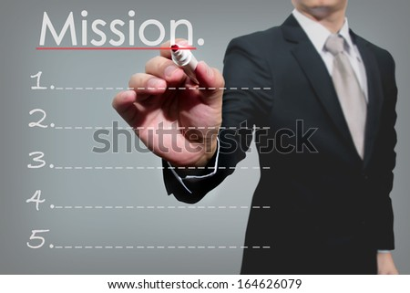 business man hand checking mission.  - stock photo