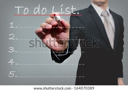 business man hand checking the to do list. - stock photo