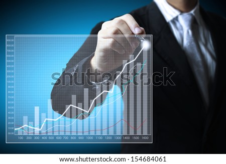 Business man hand drawing a graph