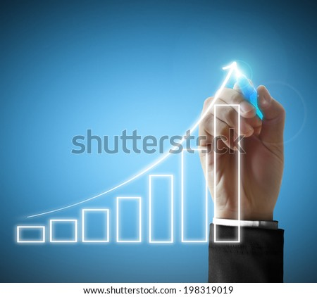 Business man hand drawing a graph  - stock photo