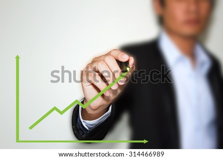 Business man hand drawing a graph. - stock photo