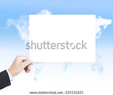 Business man hand holding A4 international paper over blurred world map of clouds background.