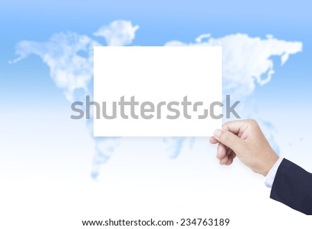Business man hand holding B5 international paper over blurred world map of clouds background.