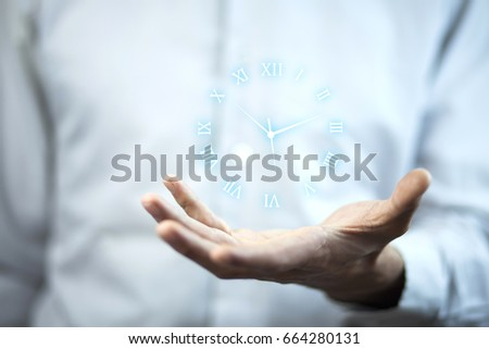 Business man hand holding clock in screen