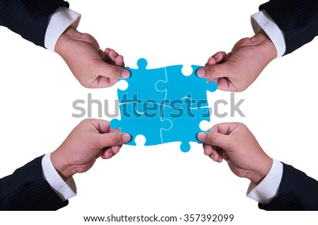 business man hand holding jigsaw isolated on white background