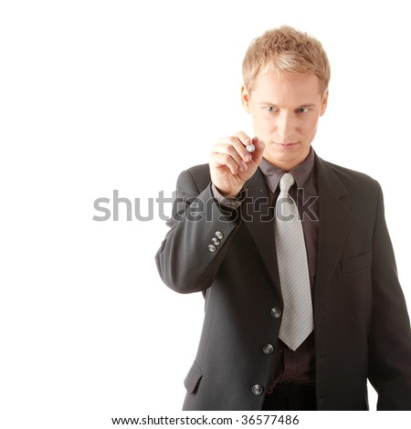 Business man hand holding pen writing on abstract screen isolated on white background