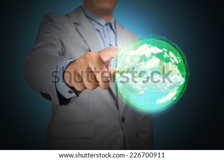 Business man hand holding planet earth glowing in crystal ball - stock photo