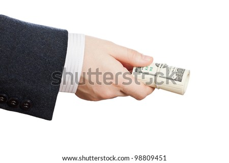 Business man hand holding rolled up paper dollar currency