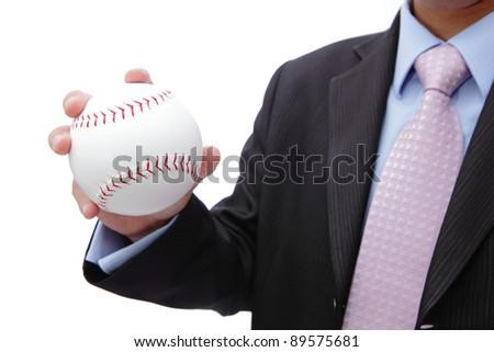 Business man hand holding white baseball - stock photo