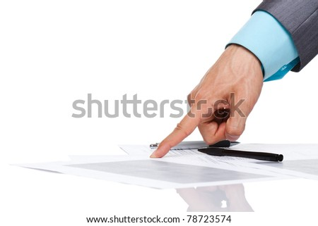 business man hand in elegant suit point finger at the document, paper on the desk, sign up contract concept. Isolated over white background. with empy copy space for text. - stock photo