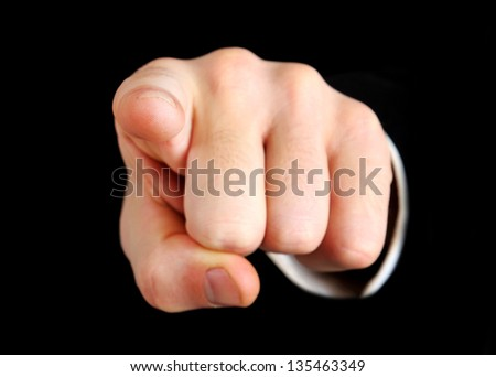 Business man hand pointing camera