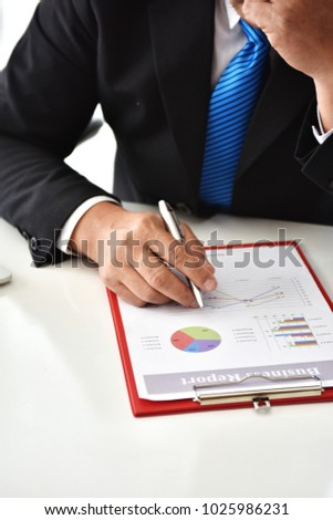 Business man hand pointing to graph information. new startup project. Idea presentation, analyze plans. Business Communication Connection Working Concept. Business People Meeting.business report.