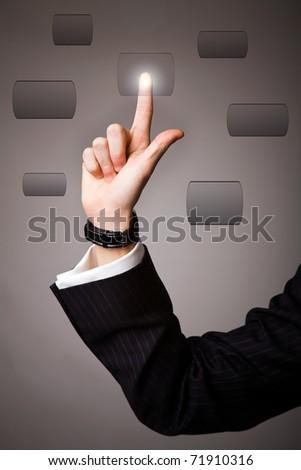business man hand pressing a touchscreen button - stock photo