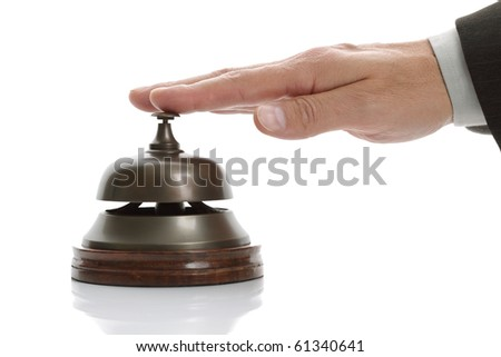 Business man hand ringing the bell for assistance - stock photo