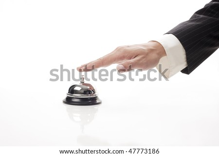 business man hand ringing the bell to call - stock photo