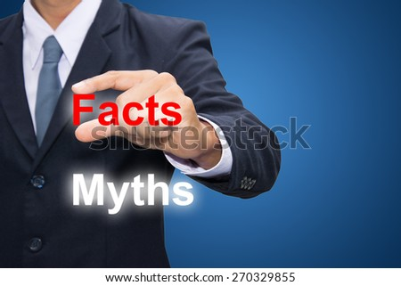 Business man Hand Showing Facts instead of Myths.  - stock photo
